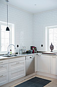 White kitchen with panelled fronts and lattice windows