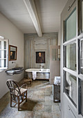 Panelled wall and stone floor in classic, French-style bathroom