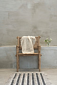Knitted cloth on bamboo chair