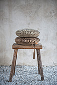 Suede cushions on wooden stool