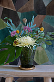 Bouquet of chrysanthemums, yarrow, drumstick flowers, starflower pincushion, zinnia, Swiss cheese plant leaves and ferns