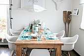 Handmade place mats on wooden table in summery dining room
