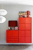 Red wall-mounted cabinets made from various modules and red accessoried