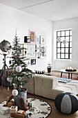 Small Christmas tree and gifts in vintage-style living room