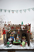 Handmade Christmas workshop diorama made from kitsch knick-knacks