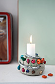 Handmade clay candle holder with colourful wooden beads