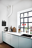 Modern kitchen with industrial-style window and festive decorations
