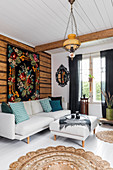 Tapestry hung on wall above sofa in Bohemian-style living room