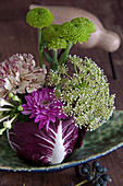 Bishop's flower, chrysanthemums, carnations and bouvardia arranged in hollowed-out radicchio