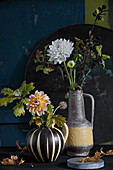Autumn bouquets of of dahlias and branches of oak and sloes