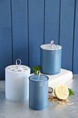 Tin cans upcycled to make decorative storage vessels with lids