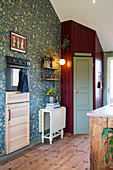 Pantry in corner of country-house kitchen with floral wallpaper