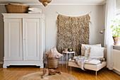 Cosy, Bohemian-style living room in beige in grey