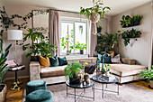 Glamorous living room full of houseplants