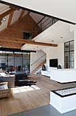 Open-plan interior in modern country-house style in converted barn