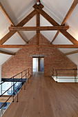 Gallery level in converted barn with brick wall