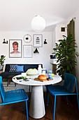 Blue chairs at round table in modern interior