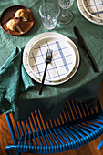 Plate with blue checked pattern on table with green tablecloth