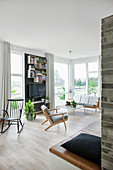Classic living room in Scandinavian style decorated in shades of grey