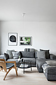 Grey sofa with black-and-white scatter cushions in simple living room