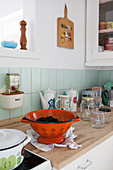Vintage-style colander and kitchen utensils