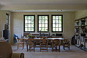 Simple dining room in rustic country house with lattice windows