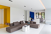 Modern, open-plan interior with brightly coloured alcoves