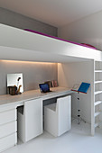 Modern desk with indirect lighting below loft bed