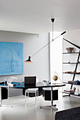 Cantilever ceiling lamp above desk in masculine interior