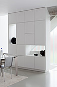 Cupboard with shelf modules used as partition in modern dining room