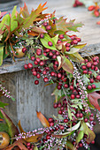 Wreath of hawthorn berries, ling and leafy branches