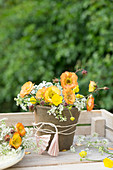 Posy of geums, buttercups and cow parsley