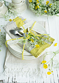 Arrangement of cow parsley and buttercups on plate for 60th birthday