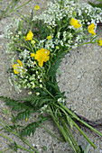 Arrangement of cow parsley and buttercups