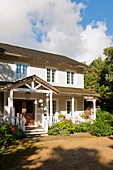 Wooden house in American country-house style with veranda