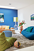 Comfortable seating in living room with blue accent wall