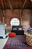 Lounge in renovated, red-brick barn