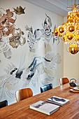 Modern chandelier of golden spheres above dining table