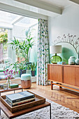 Mid-century modern living room with green and white ombré walls