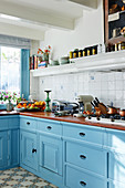 Classic country-house kitchen with light blue panelled cabinets