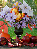 Autumn bouquet with roses, clematis and asters
