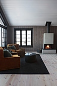 Ochre armchairs and open fireplace in modern living room