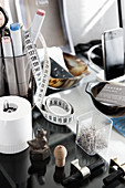 Office supplies and small sculptures on desk