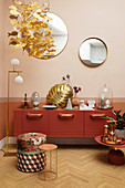 Ornaments on Marsala-red sideboard, gilt leaf, standard lamp and side tables