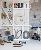 Decorative letters on white wooden shelves