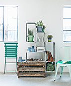 Potted herbs on modular shelving, wooden pallets and garden chairs