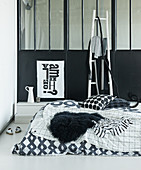 Black-and-white bed linen in sleeping area of loft apartment