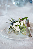 Small plate bouquet made of waxflower, eucalyptus, and gypsophila