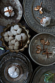 Arrangement of cotton bolls in Oriental silver bowls