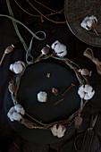 Wreath of cotton bolls, poppy seed heads and velvet ribbon